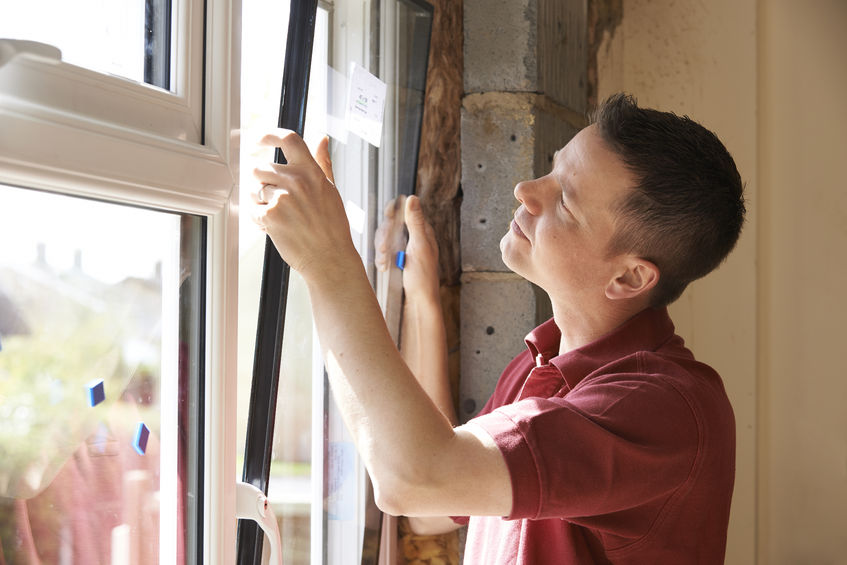 man completing window replacement